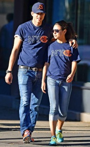 Kunis and Kutcher attend a Chicago Bears game together in 2012. <Image courtesy of usmagazine.com.